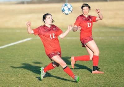 Teegan Ludwig chases down a soccer ball