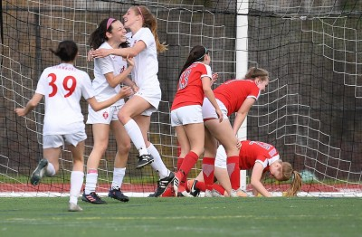 Rochelle Koly celebrating goal with Sailor Soccer Teammates