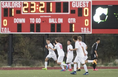 Teammates join Murphy Bohlmann in Celebration after goal against Summit
