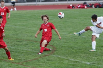 Defender Alex Coffey blocks a shot from Glenwood stricker.