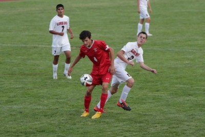 Will McConnell shields the ball from Glenwood defender