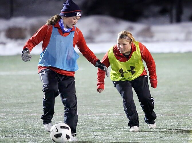 Ellese Lupori, right, and Logan Sankey run through drills Wednesday at Gardner Field. The Steamboat Springs High School girls