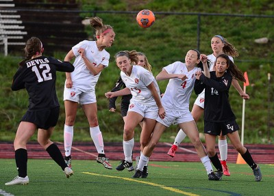 Steamboat Springs sophomore Sydney Graham heads the soccer ball toward the goal