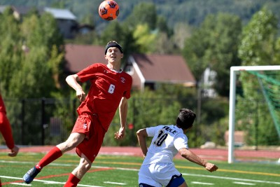 Steamboat Springs senior defender Pete Dohr heads the ball in a game against Rifle