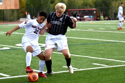 Steamboat Springs player Devon John tries to win the ball