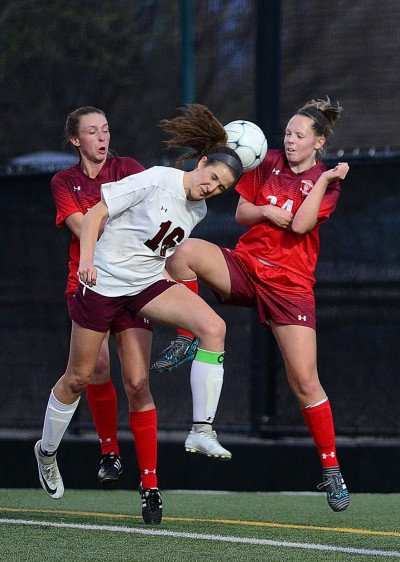 Steamboat Springs Sloan Russell goes head-to-head with Palisade's Sami Feller in the first half of Tuesday nihgt's soccer game in Palisade.